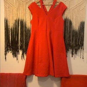 The perfect, textured, fit and flare, red dress.